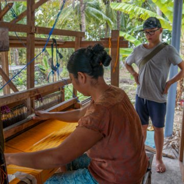 The kind woman shows me how she weaves