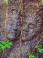 Faces carved into the stone