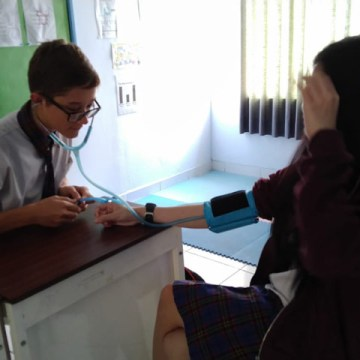 I'm measuring my school-friend's blood pressure