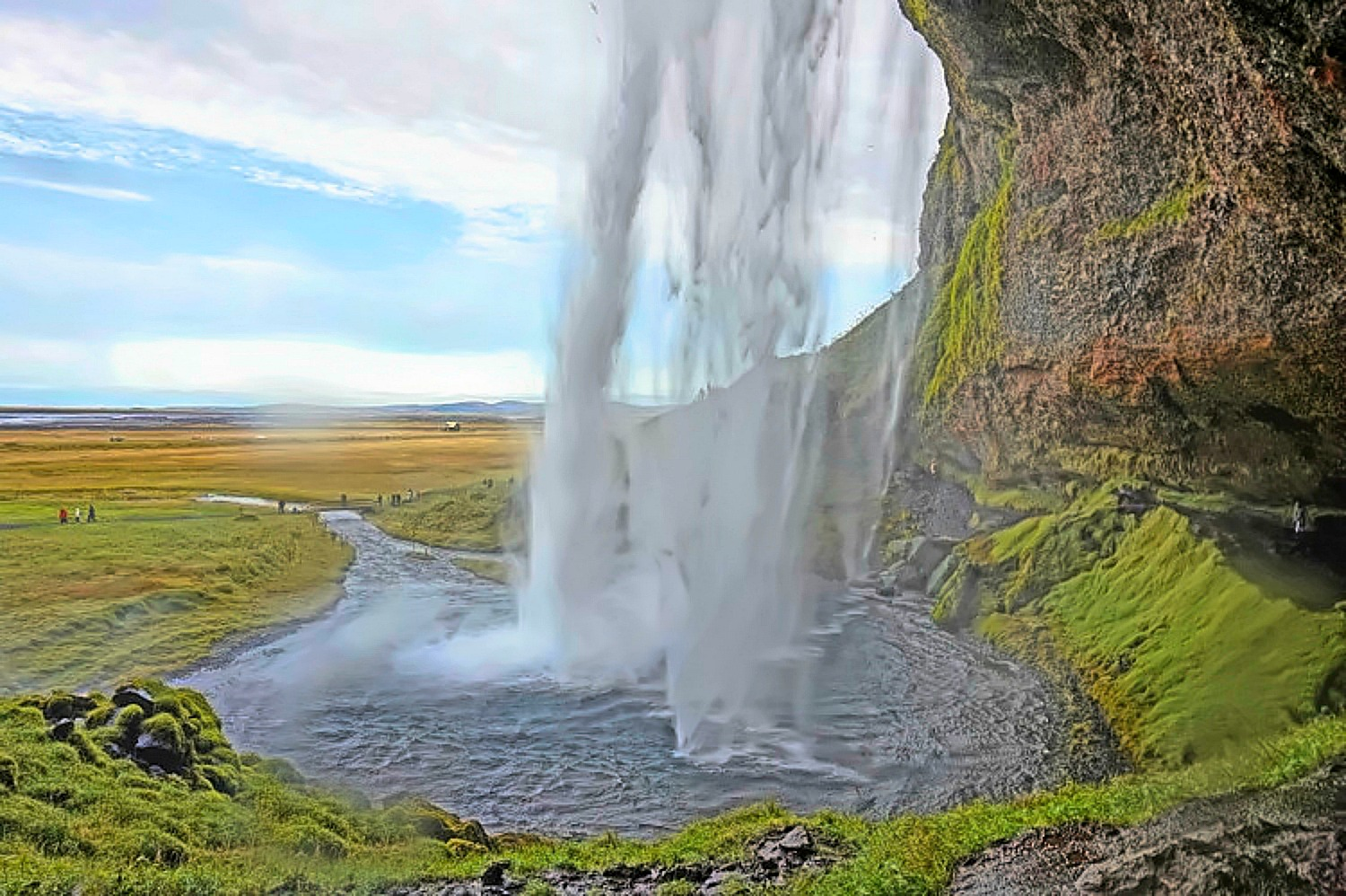 10 top reasons to visit Iceland. Seljalandsfoss waterfall is one the most popular attractions.