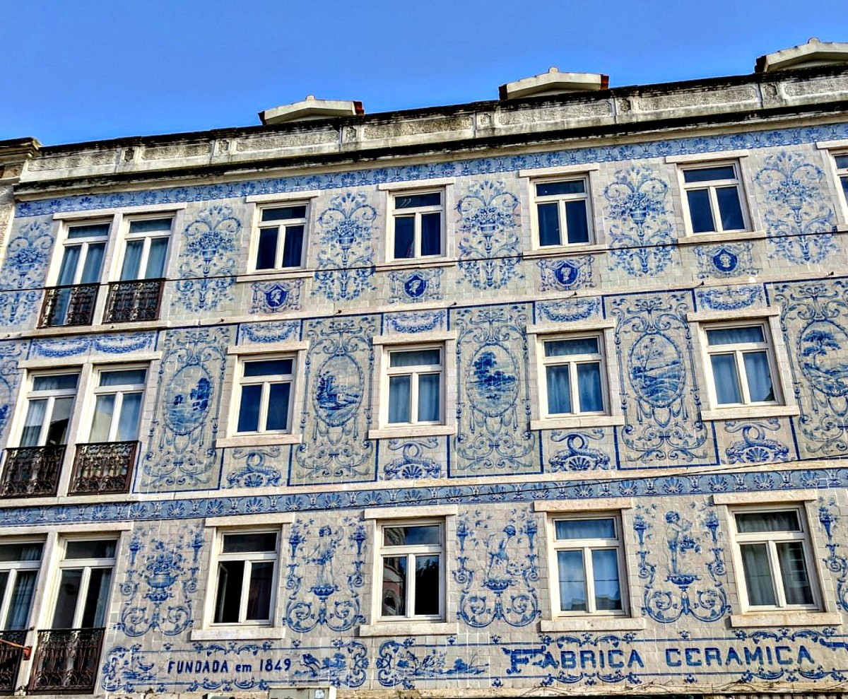 11 Top Reasons to Visit Portugal. Stunning tile facade in Lisbon.
