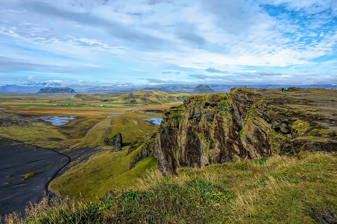 10 top reasons to visit Iceland. It is a long drive to the top of the mountain, but you will awarded with these stunning vistas near Black Sand Beach near Vik.