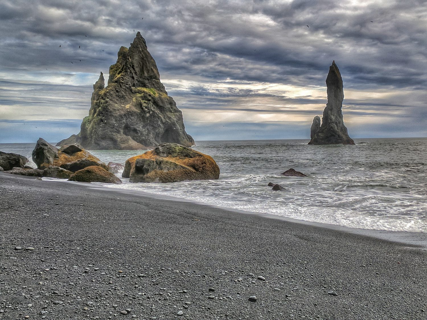 10 top reasons to visit Iceland. Reynisfjara, a world famous black sand beach in the South Coast, will capture your soul.