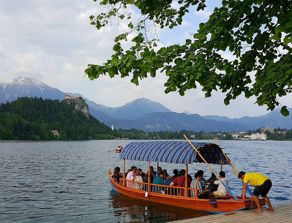 A traditional boat full of people about to take ride in Lake Bled Slovenia.