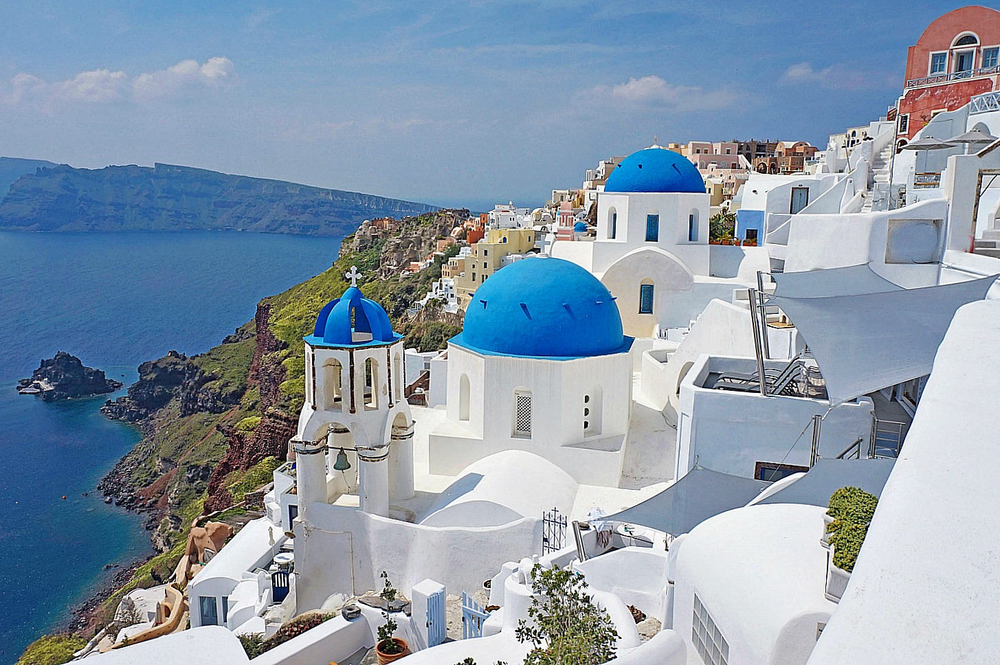 Classic view of blue domes in Oia Santorini.