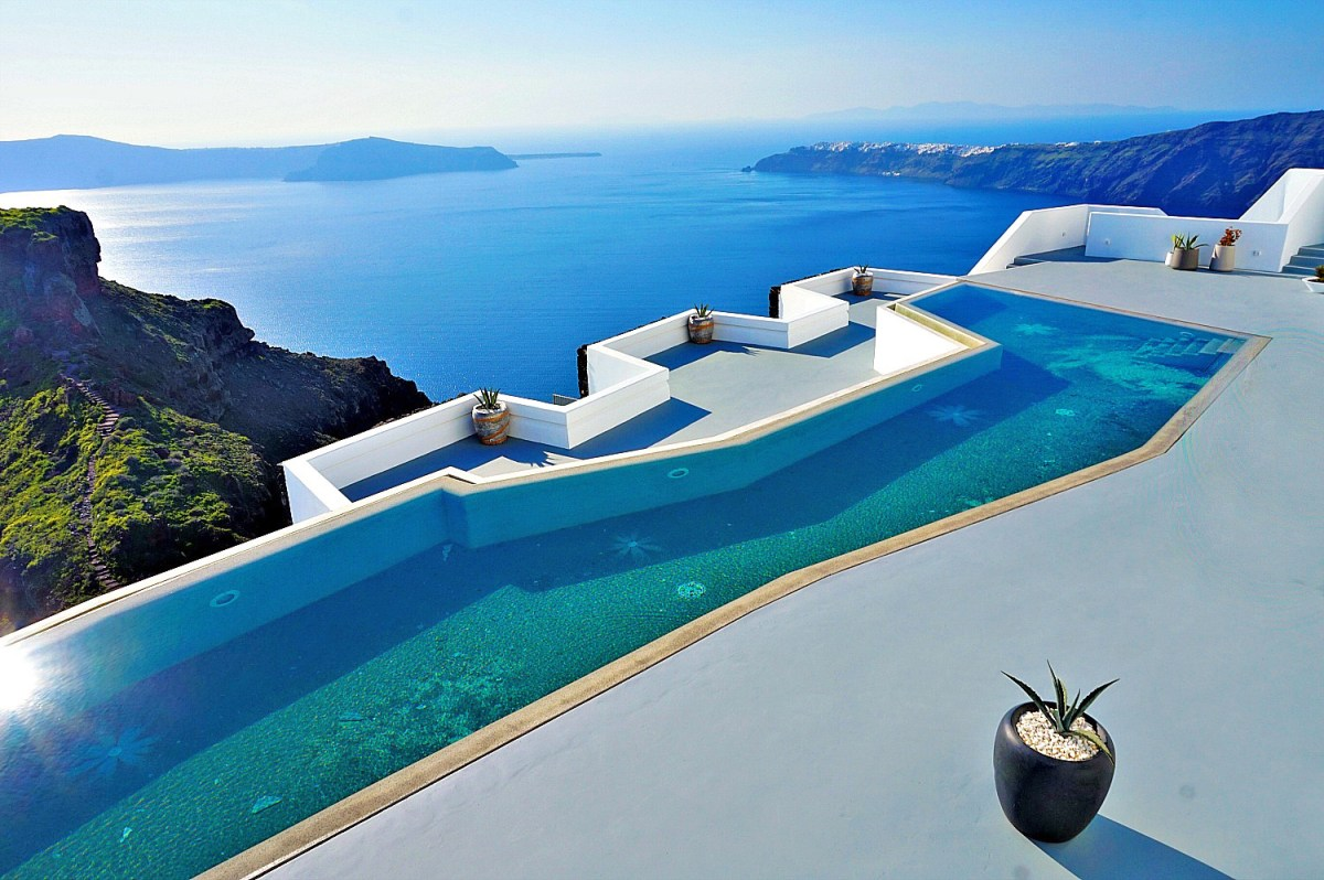 Cliffside pool with a view of the caldera in Santorini.