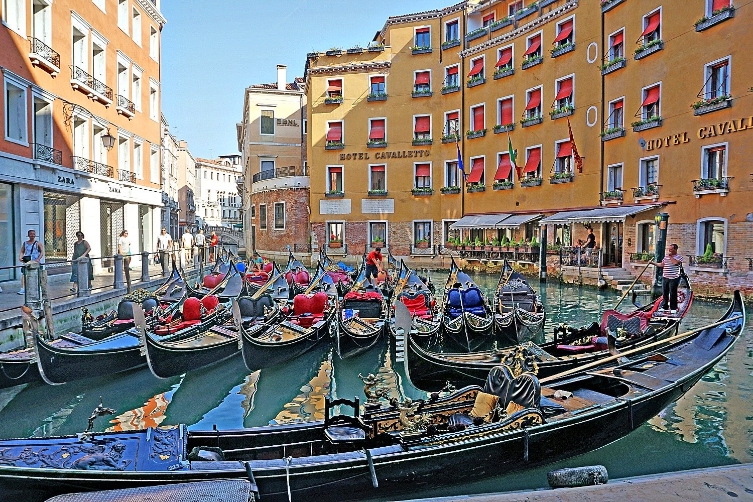 Take a gondola ride in Venice.