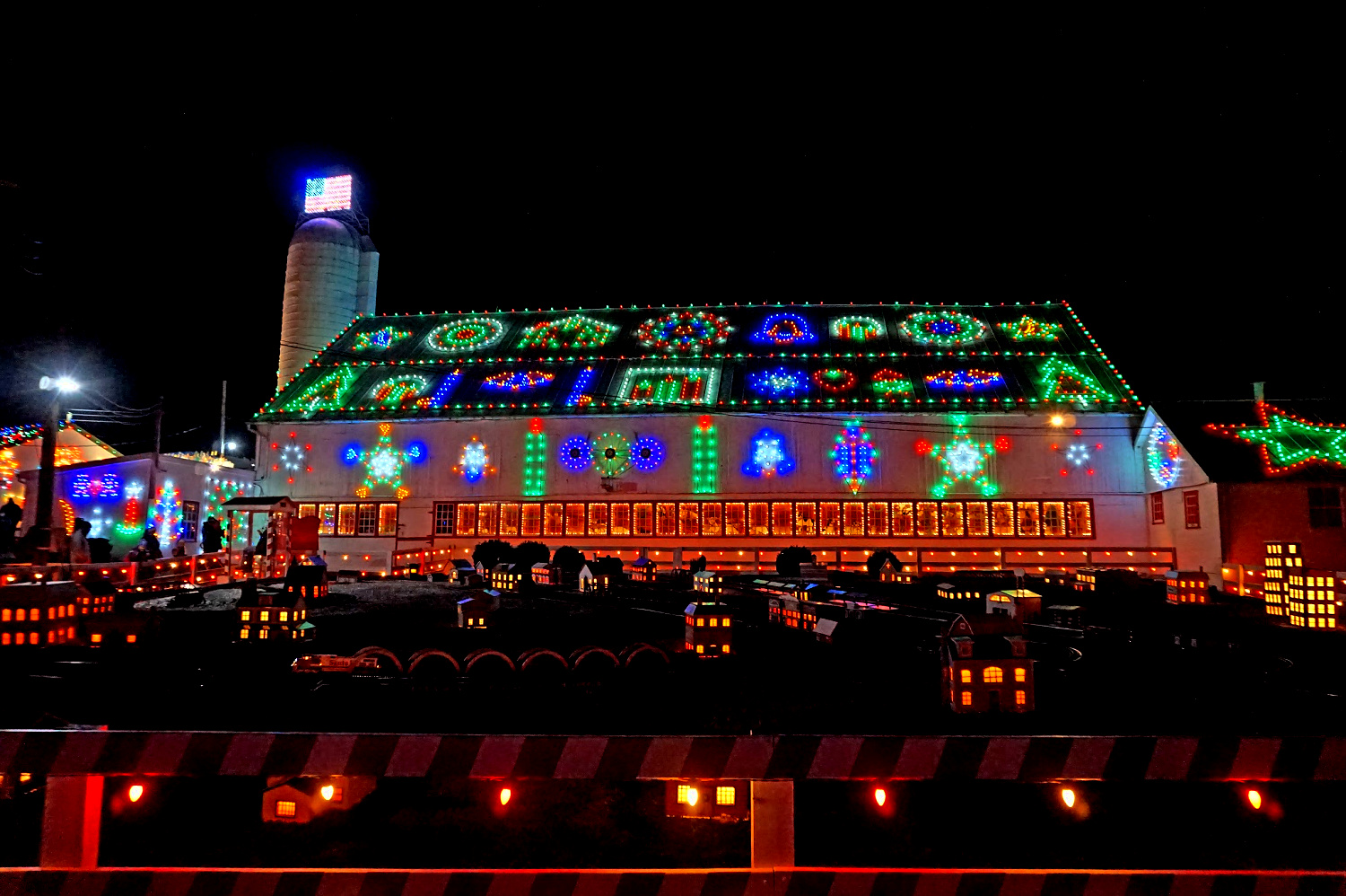Koziar's Christmas Village - a barn decorated with Christmas lights.