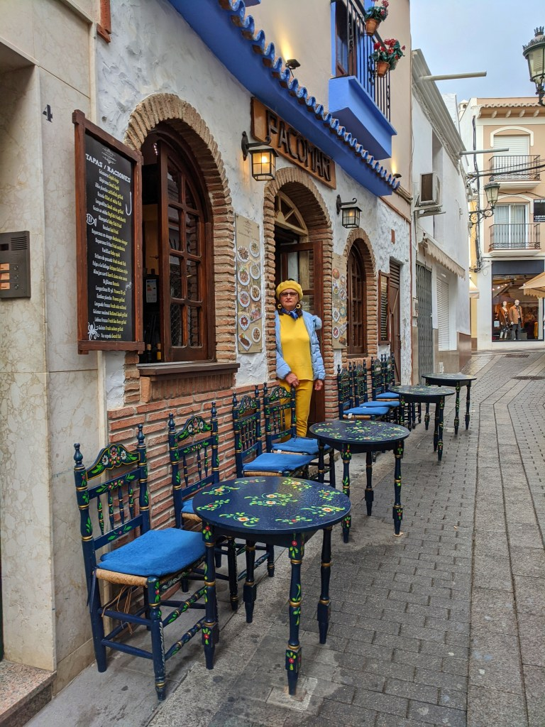Holidays in Costa del Sol - colorful outdoor cafe.