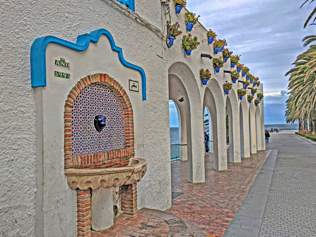 Holidays to Costa del Sol. Nerja town center with alcoves and flowerpots.