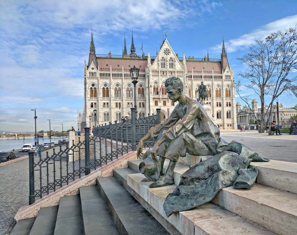 Statue of Attila Jozsef poet in front of Hungarian Parliament Building.
