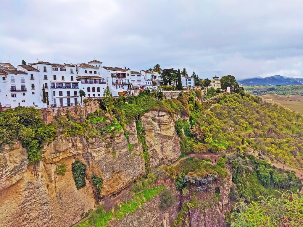 White houses on the cliff in Ronda, Spain.