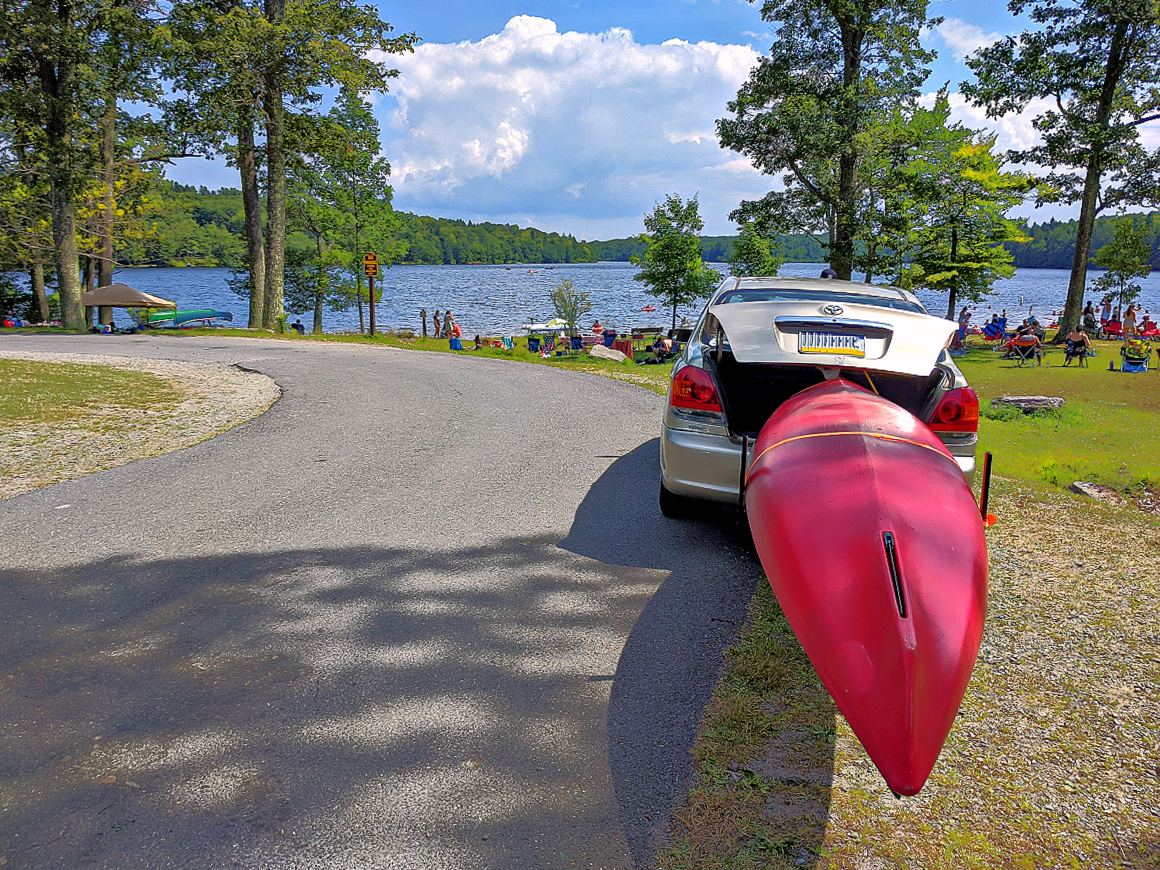 Sandy beach at Pickerel Point Campground. Main picnic area and the canoe.