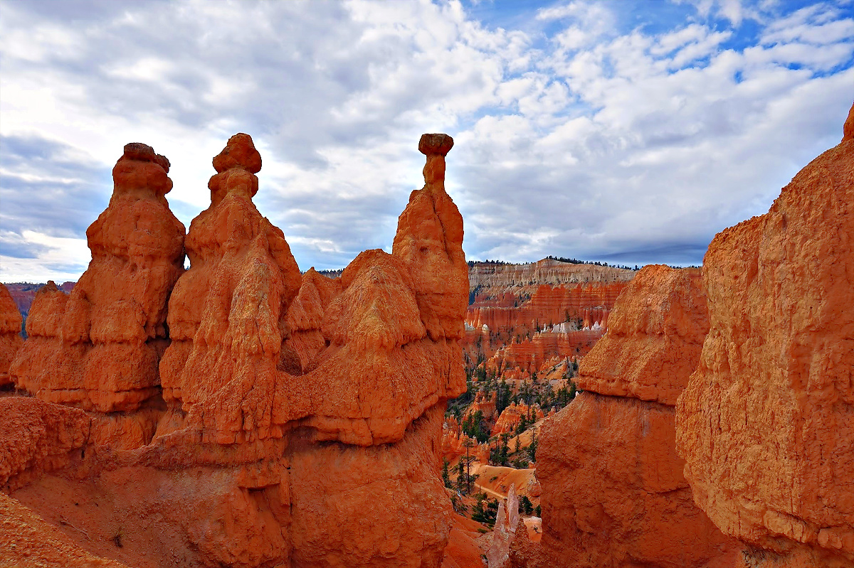 Bryce Canyon National Park. Three red rock sculptures against the sky.