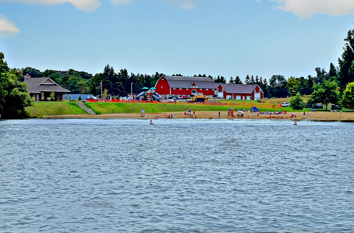 Visitors can enjoy a small beach, and recreational facilities behind it.