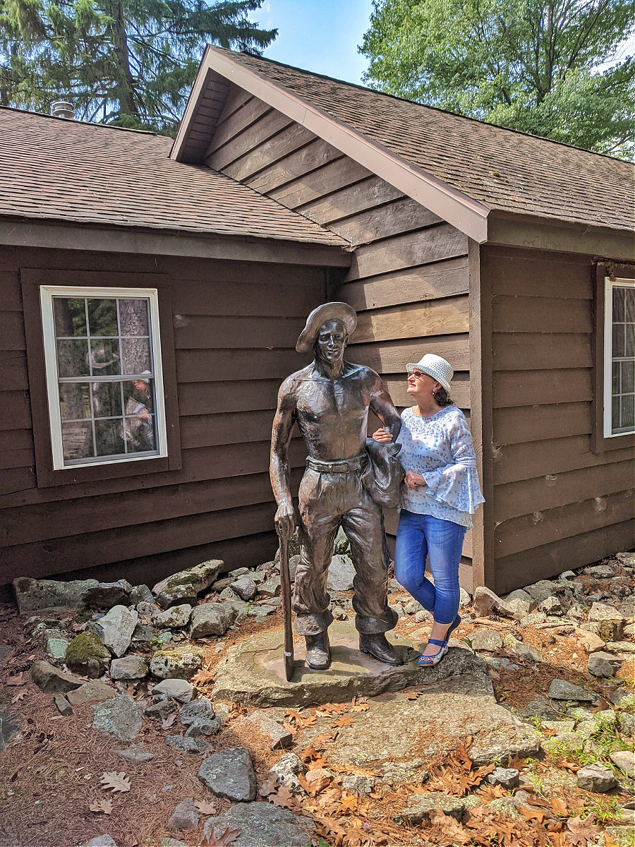 A statue of CCC boy in front of Masker Museum at Promised Land State Park.