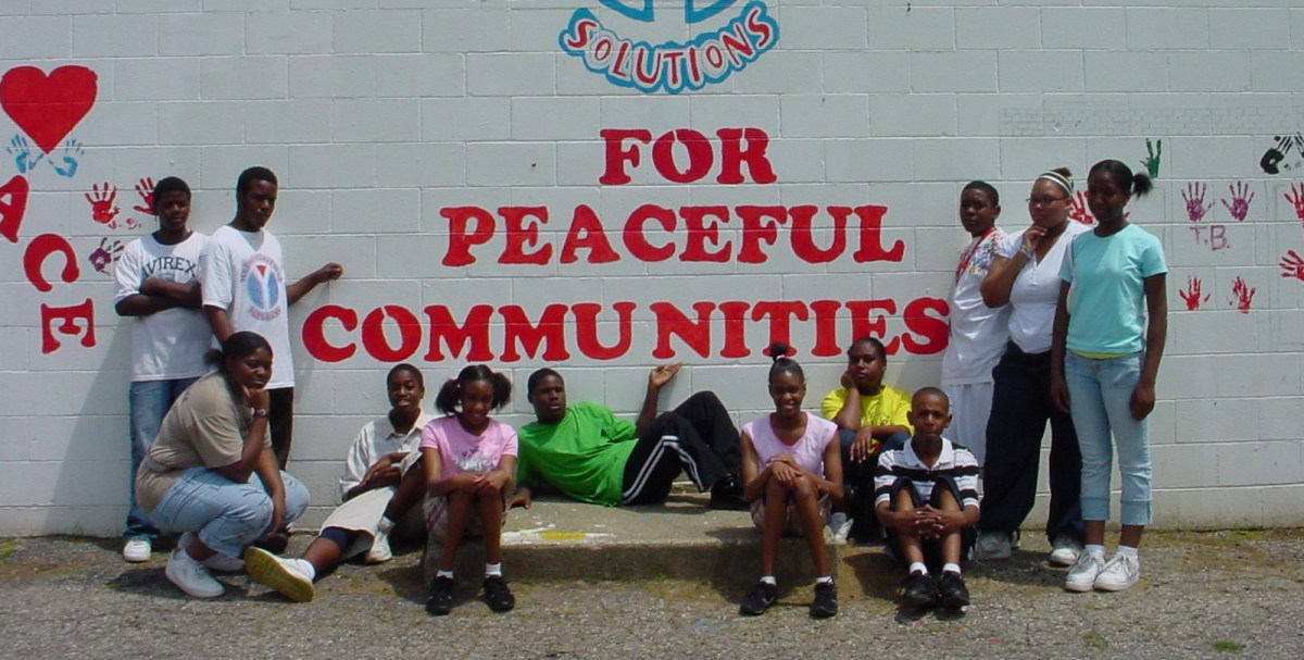 A photo of the YES Hands for Peace Mural, with the young men and women who helped create it.