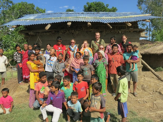 missionaries with completed house