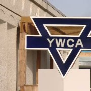 Front exterior of YWCA Regina with sign