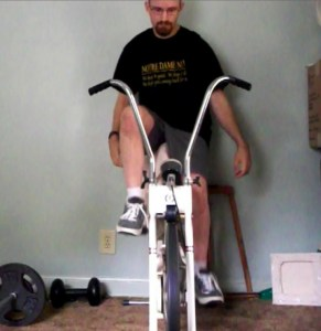 "I ride my stationary bike ""training"" for a half marathon."