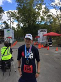 I smile and pose for a picture after completing my half marathon goal.