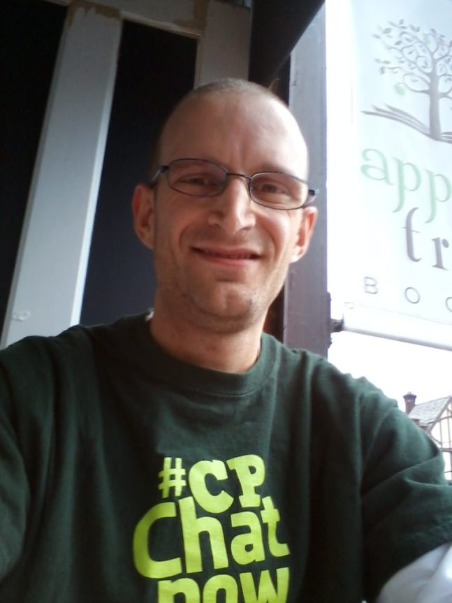 Zachary showing off his #CPChatNow shirt. printed by Custom Ink, while writing in the window at Apple Tree Books.
