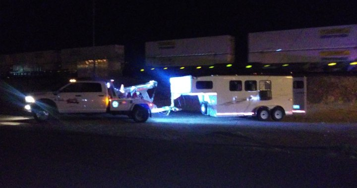 Breaking News: Downtown Needles, CA: Pickup truck pulling horse trailer gets stuck underneath North K Street Underpass.