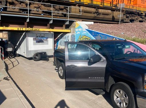 Downtown Needles, CA: Trailer being pulled by pickup truck gets stuck underneath North K Street Underpass.