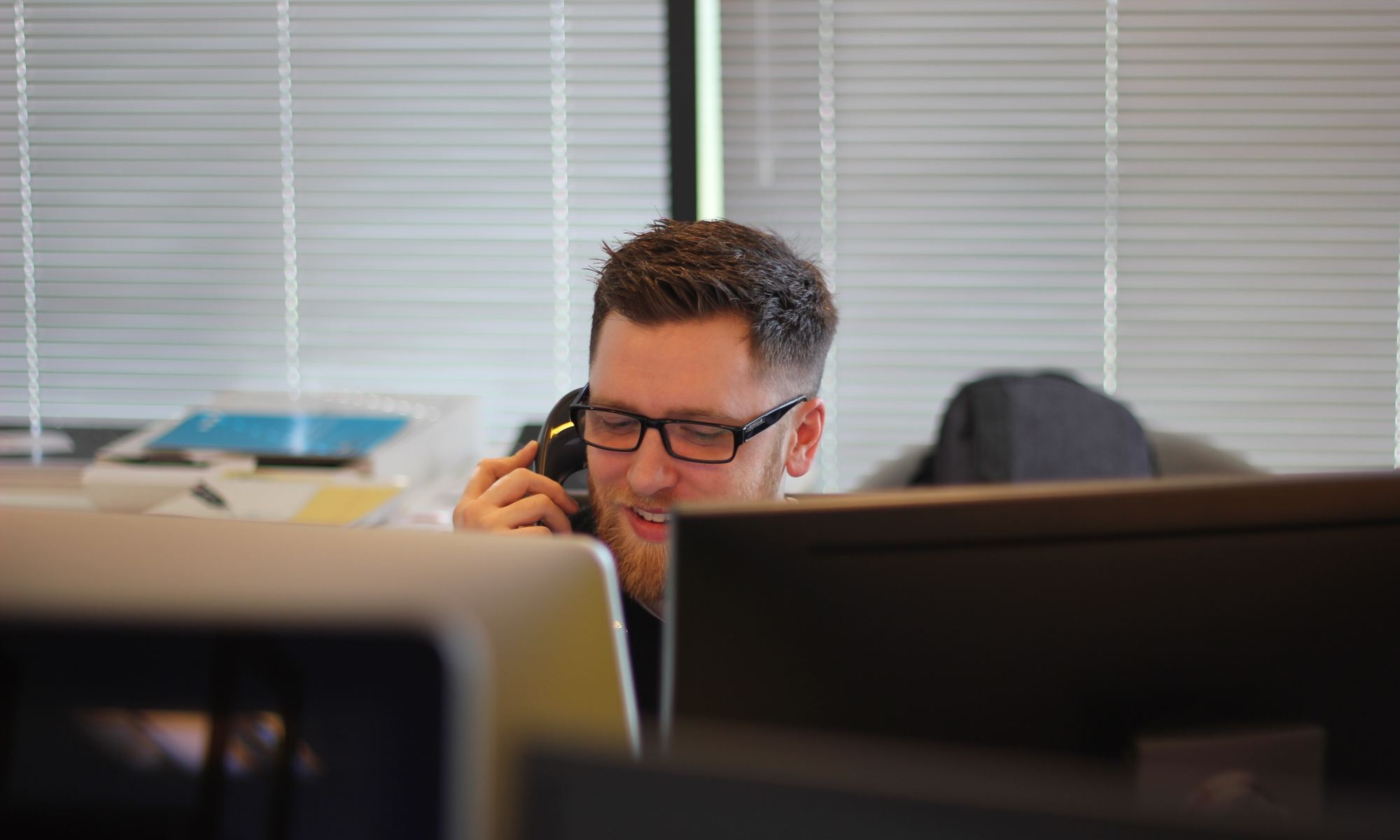 Man in office on telephone