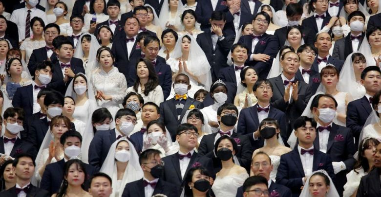 South Korea mass wedding defies coronavirus fears [Photos]