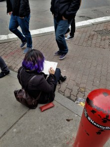 This girl was sitting on the corner drawing some of the buildings in front of her. You can't see here but the drawing was amazing.