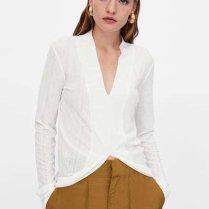 zara-camisetas-blancos-asimetrica lino vestir bien en verano