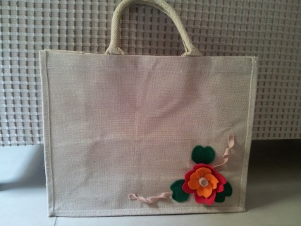 Bag decorated with felt flower