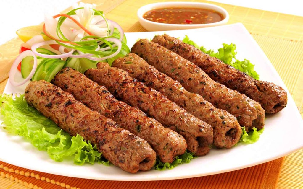 Seekh kababs on a plate complete the eid for Pakistanis