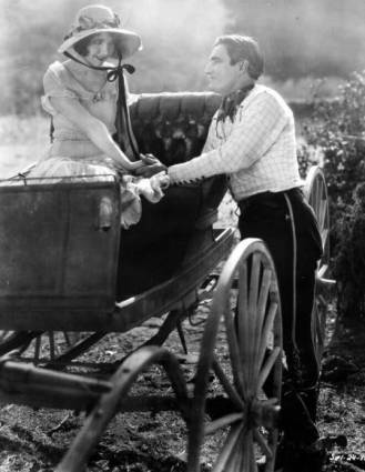 Left are Carmelita Geraghty and Tom Mix in THE LAST TRAIL (Fox, 1927)
