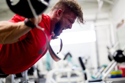 Zane Watson executing back extensions with barbell