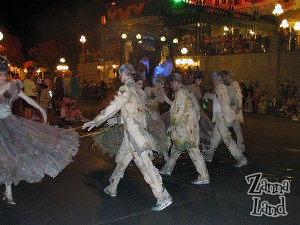 Ghoulish party-goers dance onto the scene-I love the moves they do!