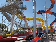 The cool half-pipe-like water slide amid the other covered slides