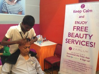 An organiser taking a break with a head massage