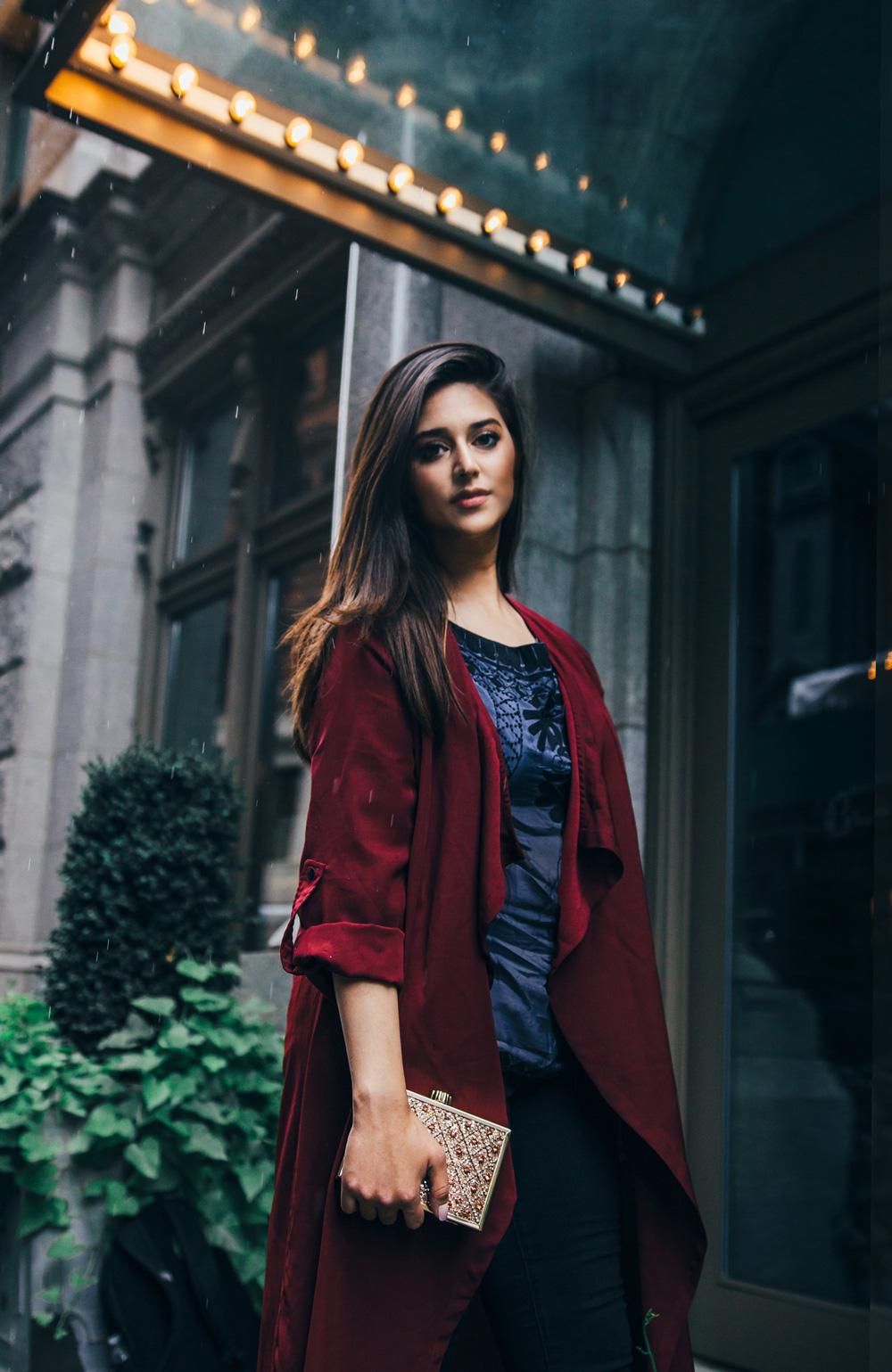 Handbag designer Minza Khan modeling her clutch