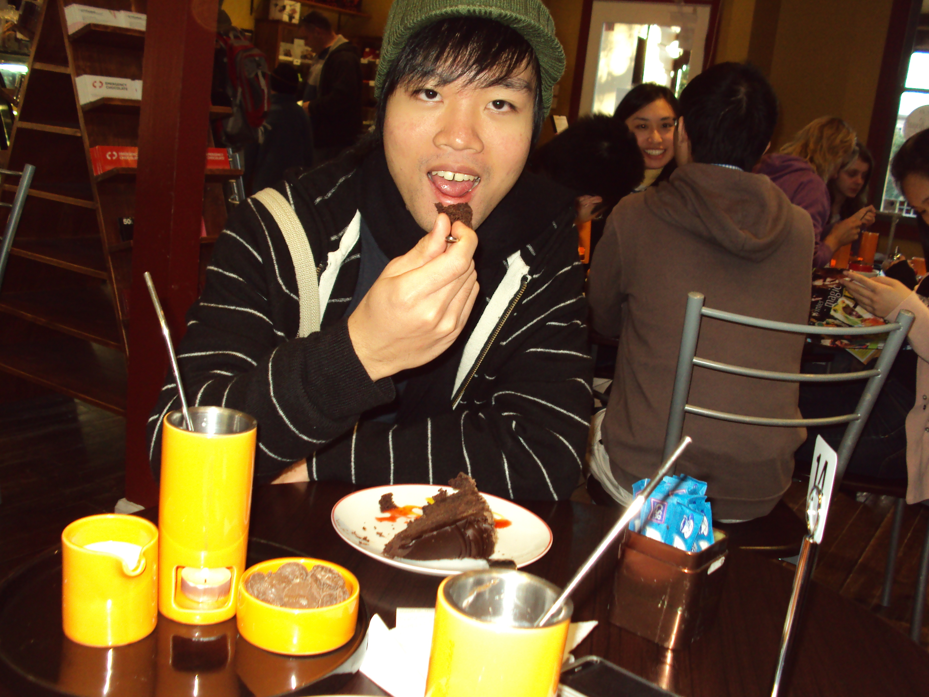 Me eating my Mud Forest Cake