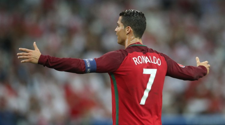 Portugal's Cristiano Ronaldo gestures during the Euro 2016 quarterfinal soccer match between Poland and Portugal, at the Velodrome stadium in Marseille, France, Thursday, June 30, 2016. (AP Photo/Petr David Josek)