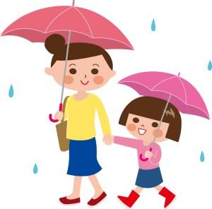 雨の中の親子