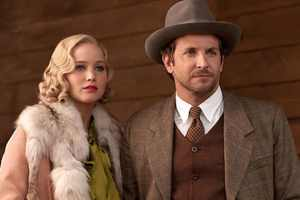 See Jennifer Lawrence & Bradley Cooper in Serena