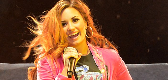 Demi Lovato Sports New Arm Sling As Accessory After Concert Performance