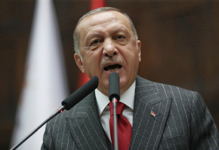 FILE - Turkey's President Recep Tayyip Erdogan addresses his MPs and supporters at parliament, in Ankara, Turkey, May 7, 2019.