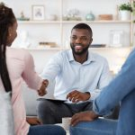 Family Counselor Shaking Hands With Happy Black Couple After Successful Therapy