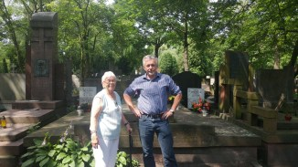 Dad and Babcia in front of the family grave