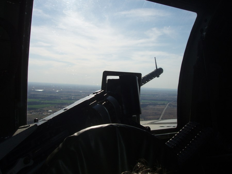 "Aerial photo from the left waist gun in Collings Foundation B-17G ""Nine-O-Nine"""