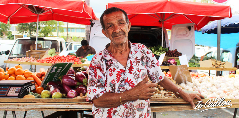 Fruits and veg creole merchant of Reunion Island on the Saint-Paul famous market